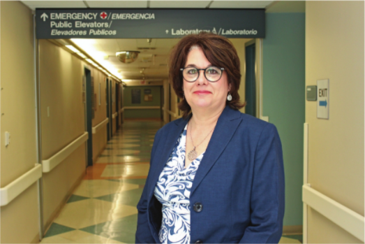 Suzanne Martinez, Chief Clinical Officer at El Centro Regional Medical Center, stands in a quiet hallway near the hospital lab.